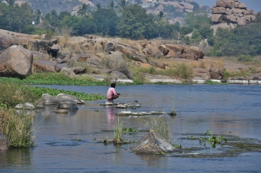 A local man fishing on Tungabhadra near Purandara Mandapa