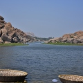 View of Pavillions on the banks between rock boulders from Chakra Theertha
