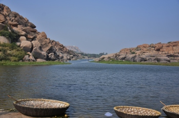 View of Pavillions on the banks between rock boulders - Chakra Theertha