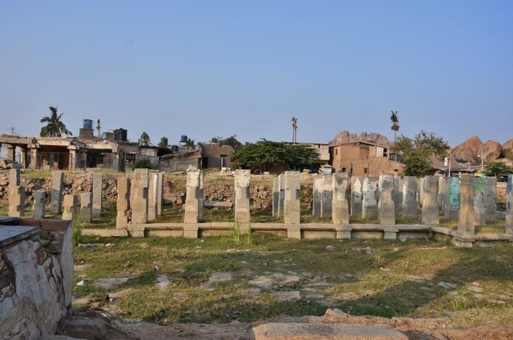 View of Ancient Hampi bazaar in front and modern Hampi bazaar in Back