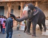 Lakshmi giving paid blessings.
