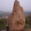 A foreigner standing near one of the stone boulders – look at the size