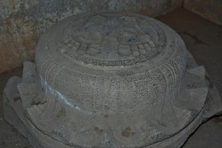 Designed stone having Jain foot prints - Inside Ganagitti Jain temple.