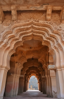 Lotus Mahal - The stucco ornamentation of cusped arches-through fragmentary is well executed.