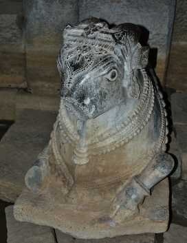 Dilapidated Nandi statue in front of Main sanctum - Prasanna Virupaksha Temple.During the monsoon season, extending from June to August, the water level rises inside the temple and submerges the floor of the maha mantapa and other mantapas.