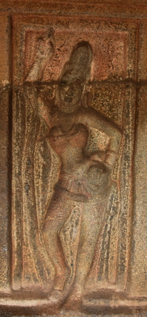 Dvarapalika, in tribhanga pose, on the right side of the shrine entrance - Kotikal Cave.