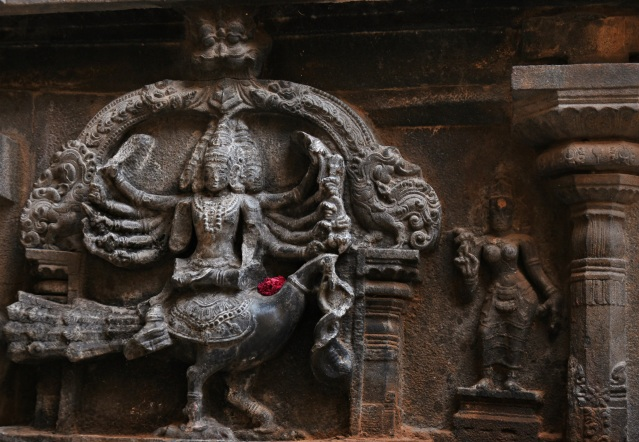 DSC_0536 - Miniature fig. of Subrahmanya with Makarathorana - found on the L side wall of N side staircase leads to sanctum.