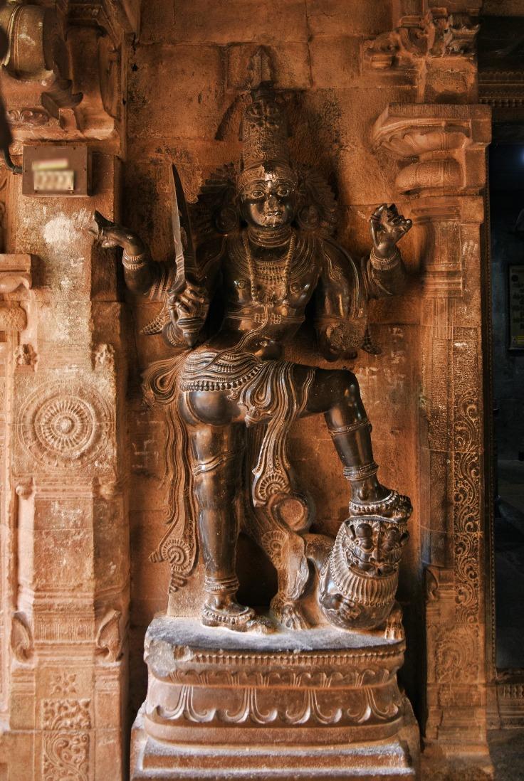 DSC_0573 - Sword carrying Dwarapalakas made out of black basalt stone guarding the Garbhagriha of Karthikeya shrine.