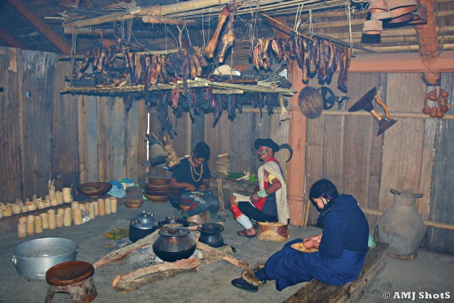 DSC_1401 Kitchen inside Chakhesang morung with hanging smoked porks.