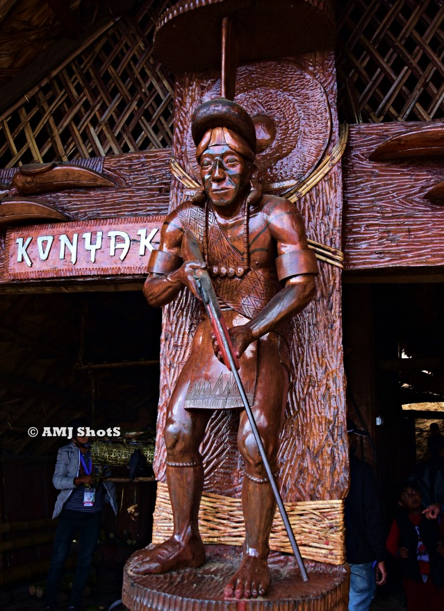DSC_1454 Wooden sculpture of Konyak tribal hunter with gun.