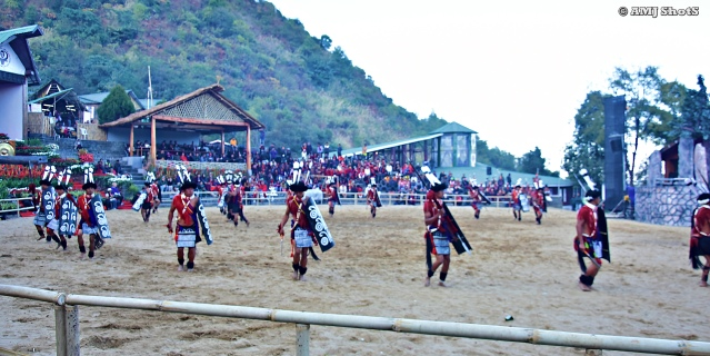 DSC_2297 Ao tribe performing head hunter's dance which signifies the procession of the warriors across the village towards the altar where the heads are to be kept.