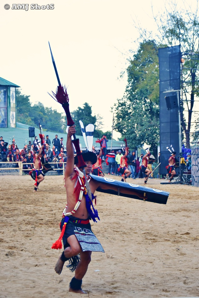 DSC_2303 Ao tribe performing head hunter's dance which signifies the procession of the warriors across the village towards the altar where the heads are to be kept.